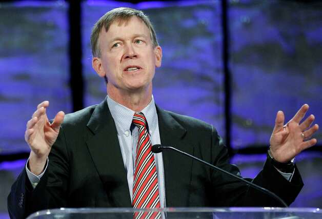 Colorado Gov. John Hickenlooper gestures as he speaks to an energy conference in Oklahoma City, Thursday, Oct. 4, 2012.   The governors of Oklahoma and Colorado say their effort to encourage manufacturers to produce compressed natural gas vehicles is gaining momentum.   (AP Photo/Sue Ogrocki) Photo: Sue Ogrocki, STF / AP