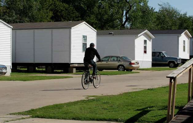 A resident rides a bicycle on the grounds of Hand Up Ministries in Oklahoma City, Wednesday, Oct. 3, 2012. Hand Up Ministries is a non profit faith-based organization that offers help to men and women coming out of the prison system to re-enter society. The grounds currently house 150 sex offenders and 7 other felons. (AP Photo/Sue Ogrocki) Photo: Sue Ogrocki, STF / AP