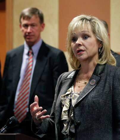 Colorado Gov. John Hickenlooper, left, looks on as Oklahoma Gov. Mary Fallin, right, answers a question at a news conference in Oklahoma City, Thursday, Oct. 4, 2012. Fallin and Hickenlooper are leading a group of 22 states that want to use compressed natural gas vehicles in their fleets. (AP Photo/Sue Ogrocki) Photo: Sue Ogrocki, STF / AP