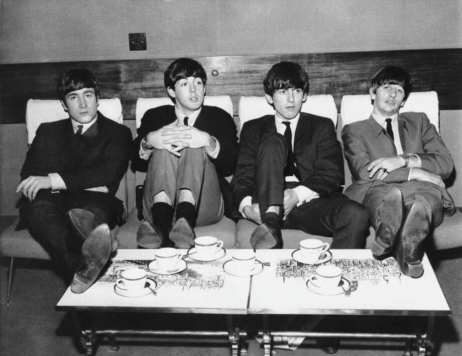 "The Beatles relax, coming off of their first single ""Love Me Do,"" which peaked at #17 on the pop music charts but will remain a historic rock and roll milestone. Photo: AP"