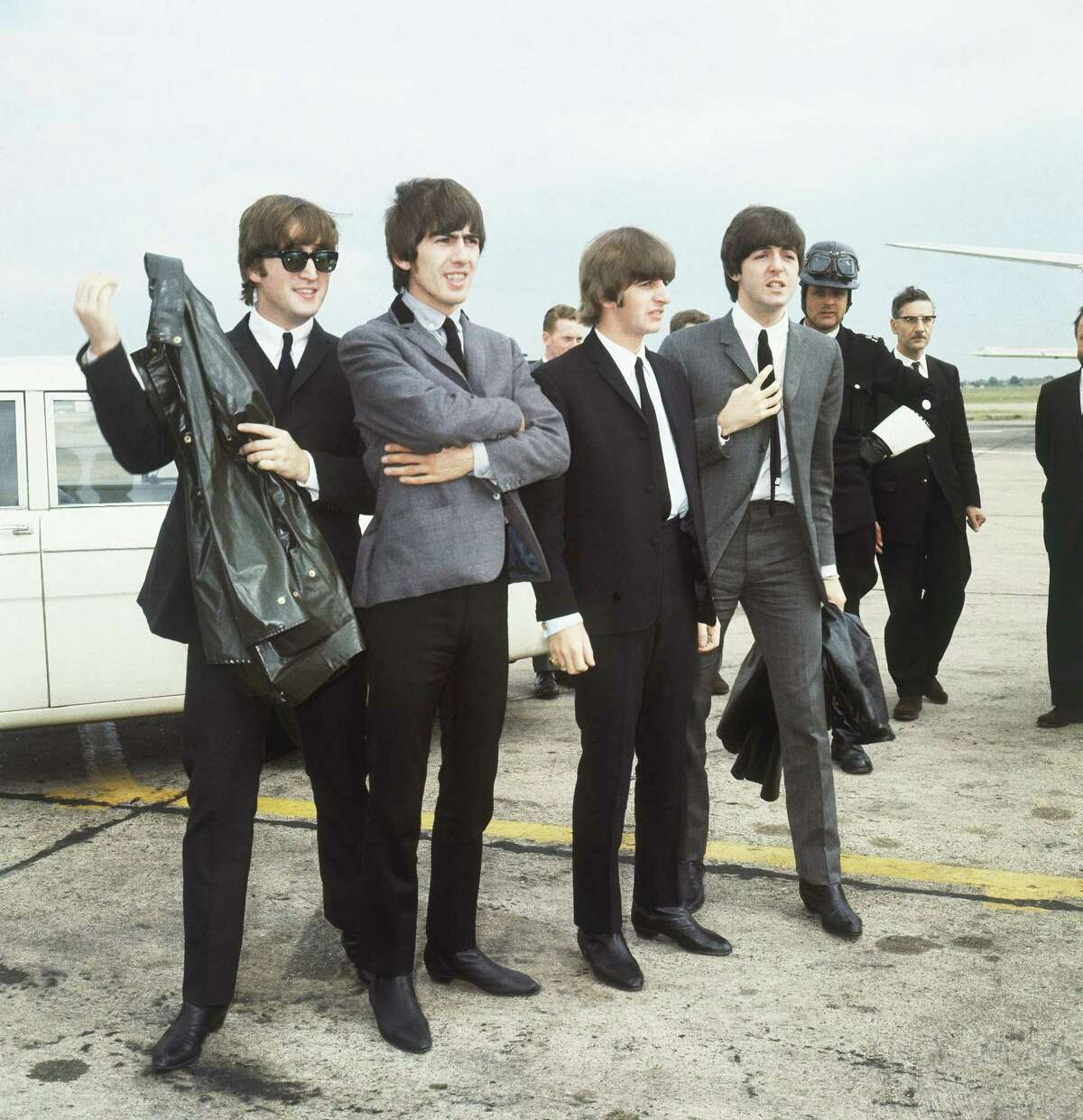 The Beatles leave London airport in 1964. From left: John Lennon, George Harrison, Ringo Starr and Paul McCartney. (AP Photo)