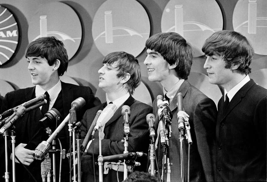 The Beatles meet reporters at Kennedy Airport in New York City, Feb. 7, 1964 on their arrival from London for their first American tour. Photo: ASSOCIATED PRESS / Associated Press