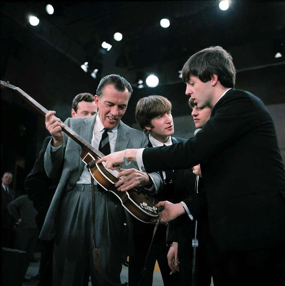 Sullivan checks out Paul McCartney's ax. Photo: AP
