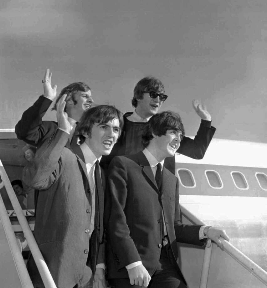 FILE--The Beatles wave after arriving at the San Francisco airport Aug. 18, 1964, to begin an American tour. Clockwise, from top right: John Lennon, Paul McCartney, George Harrison and Ringo Starr. Three decades after winning their last Grammy, the reconstituted Beatles picked up three more of the statues at this year's ceremony. Harrison, McCartney and Starr reunited to work on the Beatles' ``Anthology'' music and video series. They also recorded a pair of new songs based on leftover demo tapes from the late John Lennon. One of those songs, ``Free As a Bird,'' won for best pop performance by a duo or group and for best short video. The anthology project won for best long video.  (AP Photo/File) Photo: ASSOCIATED PRESS / Associated Press