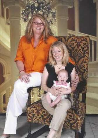 Business executive, national LGBT activist, transsexual woman and transgender advocate Meghan Stabler, left, Erin Abernathy and baby girl Evie.