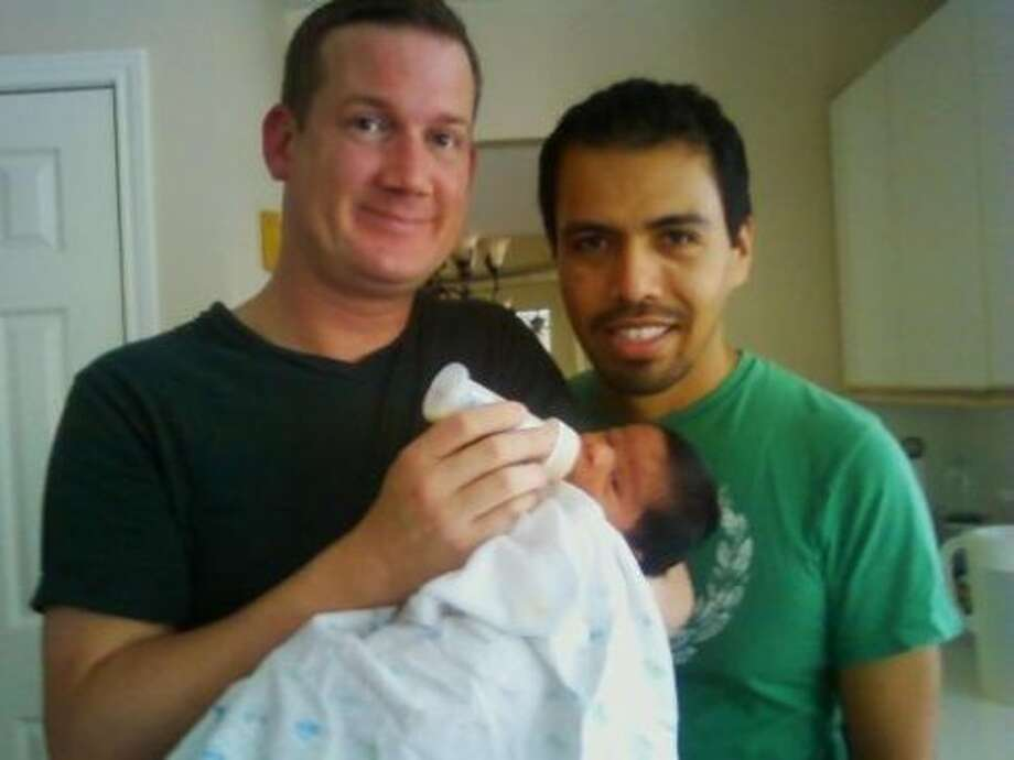 Bobby Bass, left, Adrian Robles and baby boy Ethan. (New son Roman Andrew was born Sept. 25.)