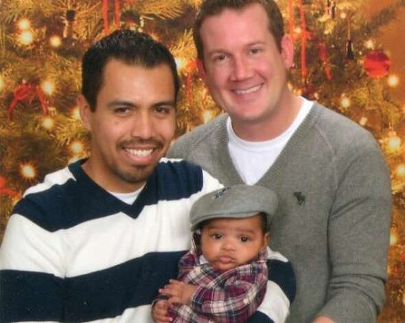 Adrian Robles, left, Bobby Bass and baby boy Ethan. (New son Roman Andrew was born Sept. 25.)