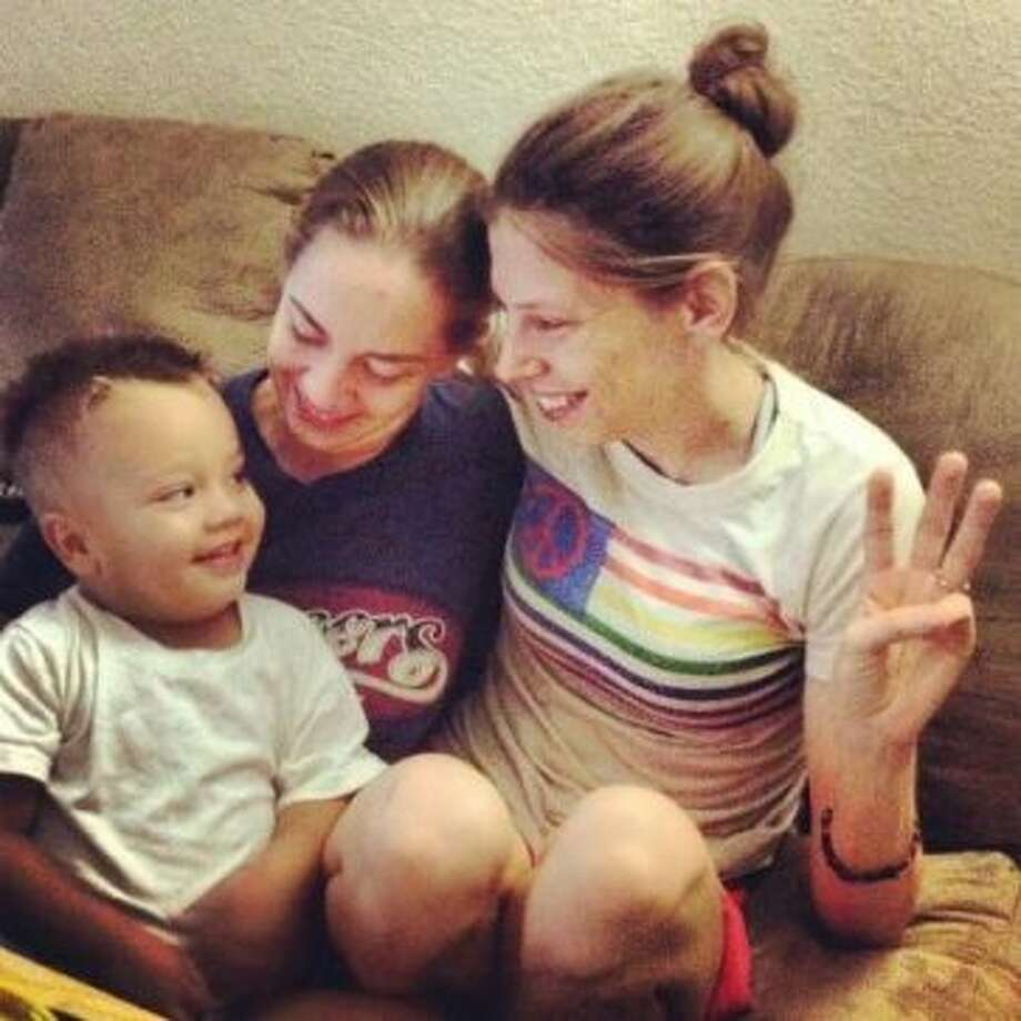 Gibson, left, with moms Casey and Courtney.