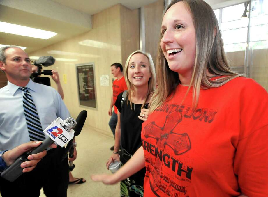 At the end of the day, after the judge had decided on an extension for the temporary restraining order, supporters Shy Seaman, left, and Patty LeDoux, right, both mothers of cheerleaders, tell the media how they felt about the judges' decision. Thursday morning, 356th District Court Judge Steve Thomas heard arguments from the Kountze cheerleaders and the school district regarding use of scriptures on signs at football games. He has to decide to order a temporary injunction, allowing the cheerleaders to use their signs or not. The hearing started at 9 a.m. Dave Ryan/The Enterprise