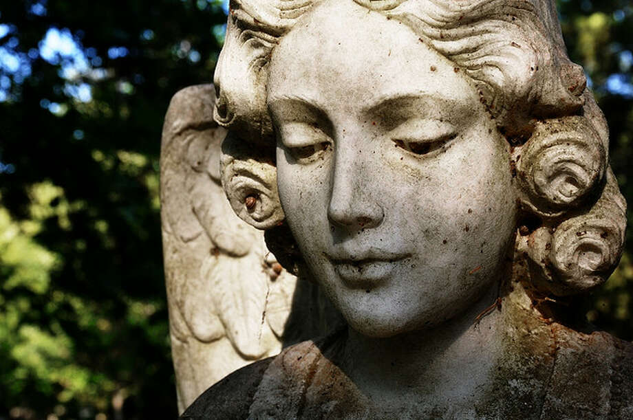 """Sculpture at the Glenwood Cemetery, Houston. Those buried here include William P. Hobby and Gene Tierney. It was once called the """"River Oaks of the Dead."""" (Theodore Scott/Flickr)"""