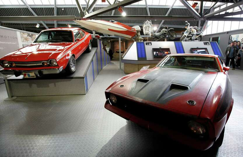 A Ford Mustang Mach 1, right, which featured in the James Bond movie 'Diamonds Are Forever' is seen