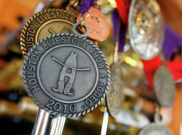 Medals for Scott Haupert's and Manny Silerio's Sandstone Cellars wines are seen Tuesday Oct. 2, 2012 at the Mason, Texas winery. Photo: William Luther, San Antonio Express-News / © 2012 San Antonio Express-News