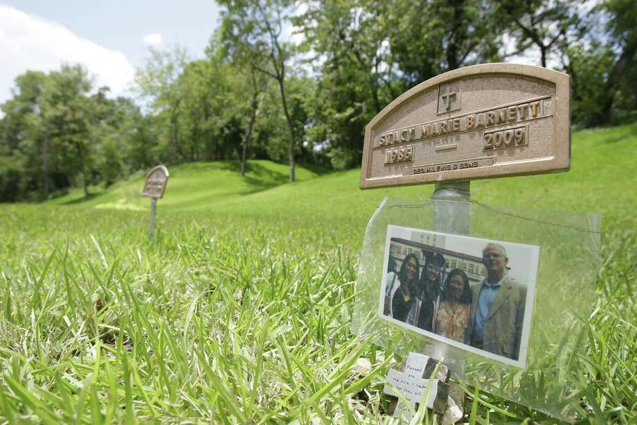 """Stacy Barnett, 22, who was killed in Austin on July 21, 2009 along with her boyfriend, John Goosey, 21, are buried side by side at Glenwood    Cemetery,  2525 Washington Ave. , shown Monday, Aug. 17, 2009, in Houston. James Ricard """"Ricky"""" Thompson, 19, has been charged with capital murder in their killing.  ( Melissa Phillip / Chronicle ) Photo: Melissa Phillip, Houston Chronicle / Houston Chronicle"""