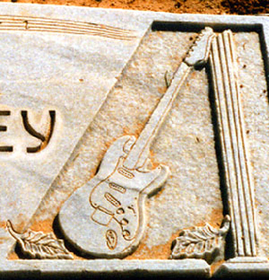 Detail from Buddy Holley's grave in Lubbock.
