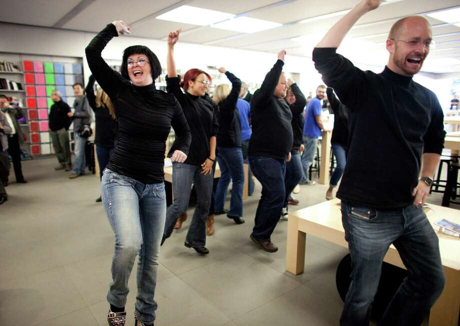 "People dance to Gangnam Style during a flash mob honoring Apple co-founder Steve Jobs on Fridayat the University Village Apple Store in Seattle. Oct. 5 is the one-year anniversary of the death of the innovative technology leader. The flash mob was organized by Filter digital agency  and participants wore Jobs' signature black turtlenecks, jeans and glasses. The event payed homage to Jobs' quote during a 2005 speech at Stanford University: ""Stay hungry, Stay foolish!"" Photo: JOSHUA TRUJILLO / SEATTLEPI.COM"