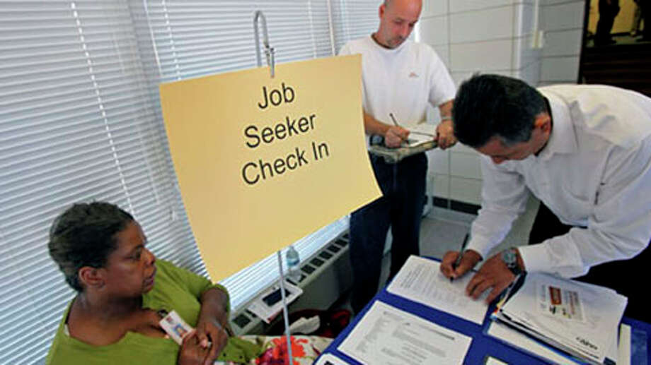 "Job seekers check in at a ""Hire A Vet"" job fair sponsored by the Illinois Department of Employment Security in Addison, Illinois, U.S., on Thursday, Sept. 6, 2012. Claims for unemployment benefits fell to the lowest level in a month and American companies added more workers than forecast, easing concern the labor market may be stagnating. Photographer: Tim Boyle/Bloomberg Photo: Tim Boyle, . / © 2012 Bloomberg Finance LP"