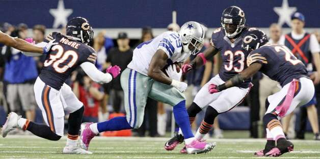 Dallas Cowboys' DeMarco Murray looks for room between Chicago Bears' D.J. Moore (from left), Chicago Bears' Charles Tillman, and Chicago Bears' Major Wright during second half action Monday Oct. 1, 2012 at Cowboys Stadium in Arlington, Tx.  The Bears won 34-18. (Edward A. Ornelas / San Antonio Express-News)