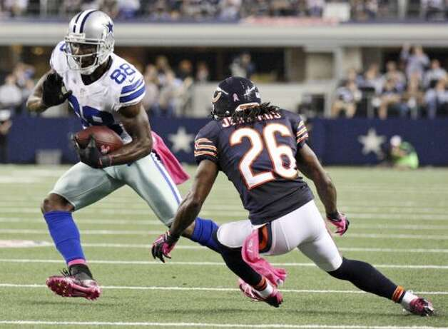 Dallas Cowboys' Dez Bryant looks for room around Chicago Bears' Tim Jennings during first half action Monday Oct. 1, 2012 at Cowboys Stadium in Arlington, Tx. (Edward A. Ornelas / San Antonio Express-News)