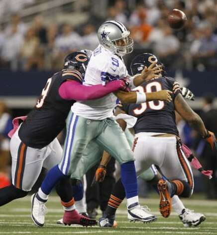 Chicago Bears defensive tackle Henry Melton (69) hits Dallas Cowboys quarterback Tony Romo (9) causing a fumble that was returned for a touchdown at Cowboys Stadium in Arlington, Texas, Monday, October 1, 2012. (Ron T. Ennis / McClatchy-Tribune News Service)