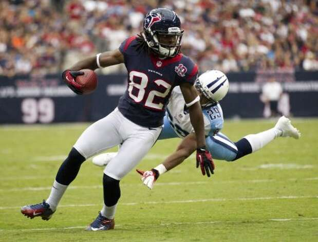 Houston Texans wide receiver Keshawn Martin (82) breaks away from Tennessee Titans defensive back Ryan Mouton (29) after a reception during the first quarter at Reliant Stadium on Sunday, Sept. 30, 2012, in Houston.  (Brett Coomer / Houston Chronicle)