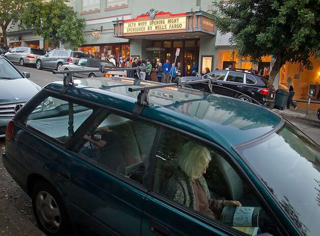 A woman reads a book in a car at the opening of the Mill Valley Film Festival in Mill Valley, Calif., is seen on Thursday, Oct. 4th, 2012. Photo: John Storey, Special To The Chronicle
