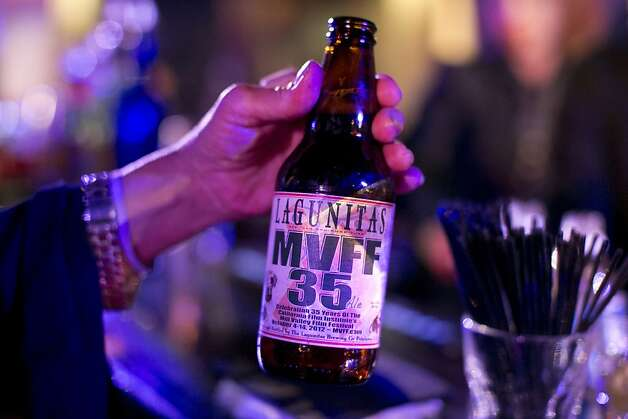 A bottle of the special anniversary brew Lagunitas made to celebrate the 35th year of the Mill Valley Film Festival is passed to a guest of the festival's opening night gala in Mill Valley, Calf., on Thursday, October 4, 2012. Photo: Laura Morton, Special To The Chronicle