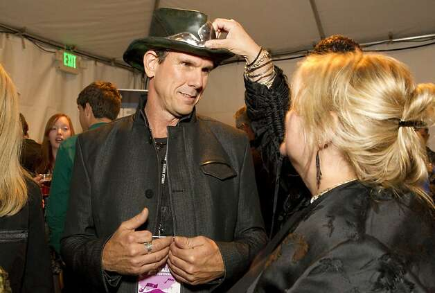 Kim Enzensperger inspects Paul Babbitt's hat during the Mill Valley Film Festival Opening Night Gala in Mill Valley, Calf., on Thursday, October 4, 2012. Photo: Laura Morton, Special To The Chronicle