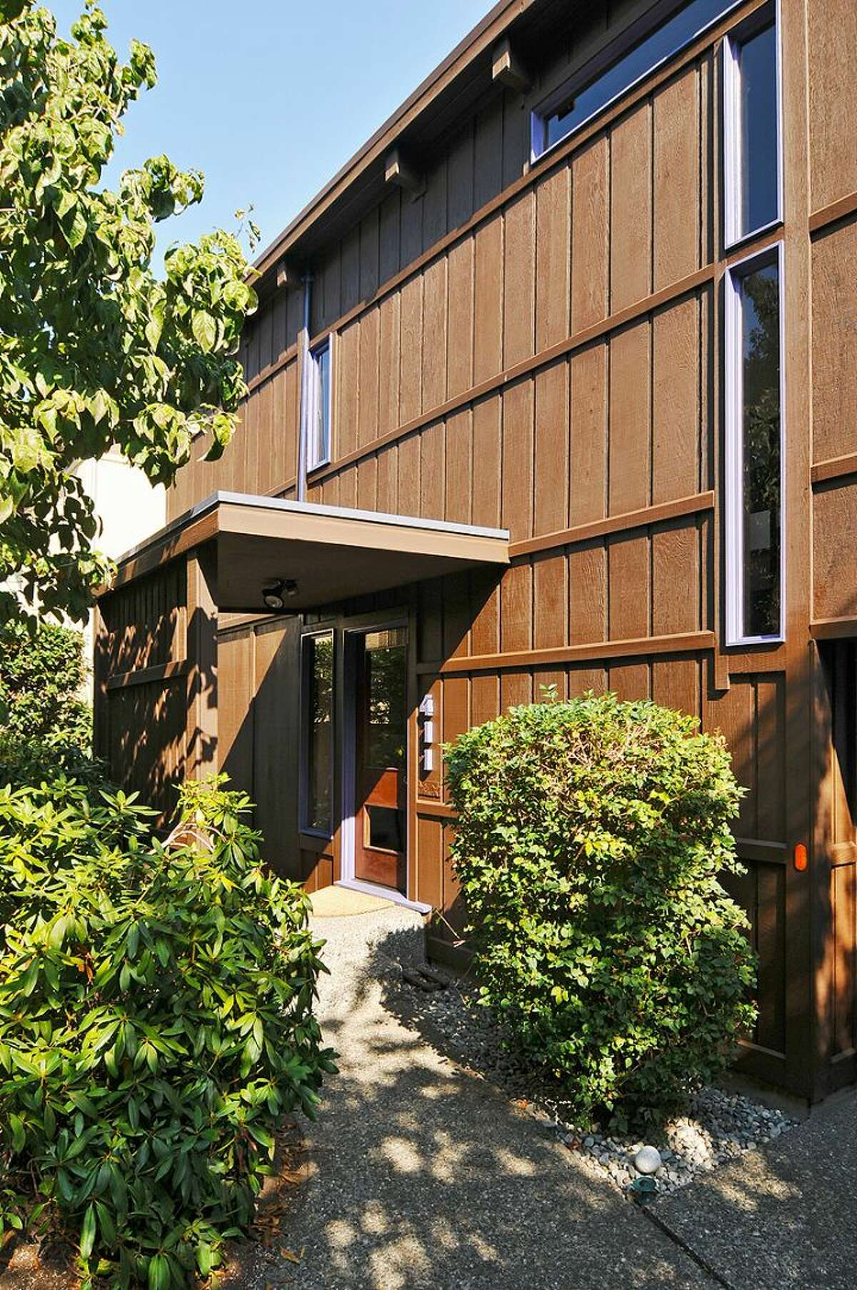 Front of 411 Erie Ave., in Leschi. The 2,440-square-foot house, built in 1970, has three bedrooms, two bathrooms, wood doors, moldings, stairways, ceilings and beams, walls of windows looking over Lake Washington, along with a view deck on a 6,600-square-foot lot. It's listed for $850,000.