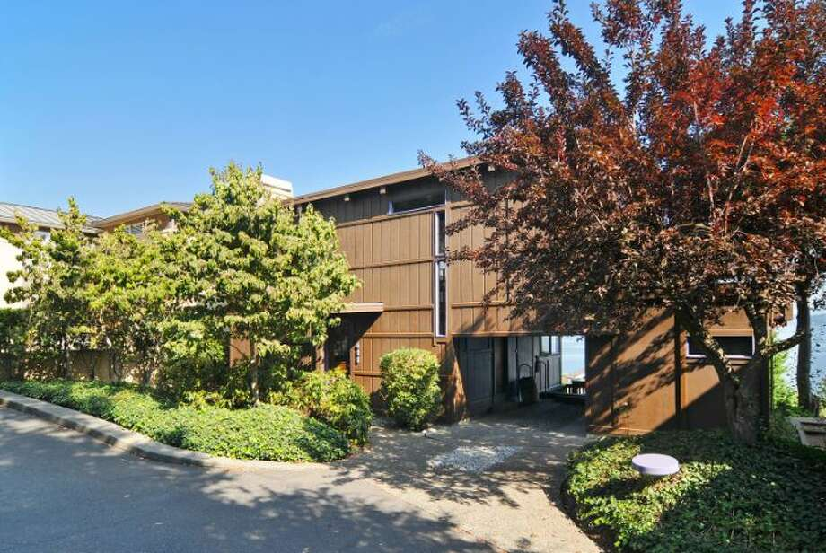 """Theodore """"Ted"""" Dixon Bowerwas one of a handful of graduates from Taliesin, Frank Lloyd Wright's architecture school, who practiced in Washington in the 1950s and 1960s. Now, you can live in one of his homes, 411 Erie Ave., in Leschi. The 2,440-square-foot house, built in 1970, has three bedrooms, two bathrooms, wood doors, moldings, stairways, ceilings and beams, walls of windows looking over Lake Washington, along with a view deck on a 6,600-square-foot lot. It's listed for $850,000. Photo: Courtesy Patty Allen/Windermere Real Estate"""