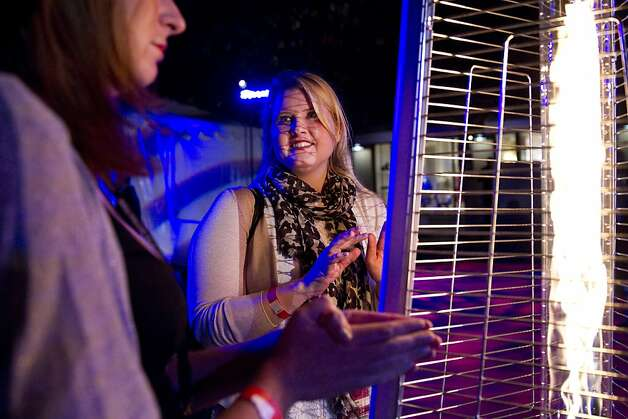 Jennie-Marie Adler (left) and Katy Hogan warm themselves by a heat lamp while attending the Mill Valley Film Festival Opening Night Gala, which was set up in the downtown plaza in Mill Valley, Calf., on Thursday, October 4, 2012.  The party celebrated the festival's 35th year. Photo: Laura Morton, Special To The Chronicle