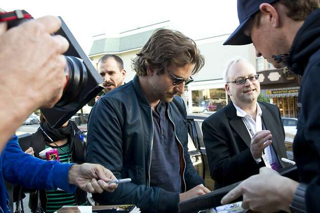 "Actor Bradley Cooper signs autographs after arriving at the Mill Valley Film Festival in Mill Valley, Calf., on Thursday, October 4, 2012.  Bradley starred in the film ""Silver Linings Playbook,"" which was one of the films being shown on opening night. Photo: Laura Morton, Special To The Chronicle"