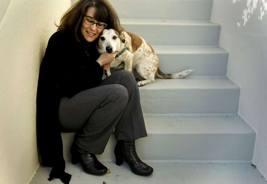 Lori Hope, shown with her dog Bean, became the public face for cancer after her 2002 diagnosis. Photo: Michael Macor, The Chronicle