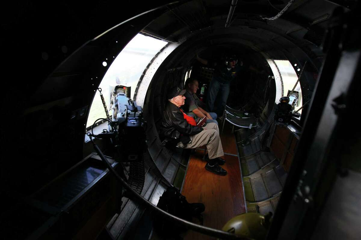 Joe Urice from Kerrville, 88, of the 100th BG (bomb group), takes in the sights and sounds of the waist, as he got to ride on the WWII B-17G bomber
