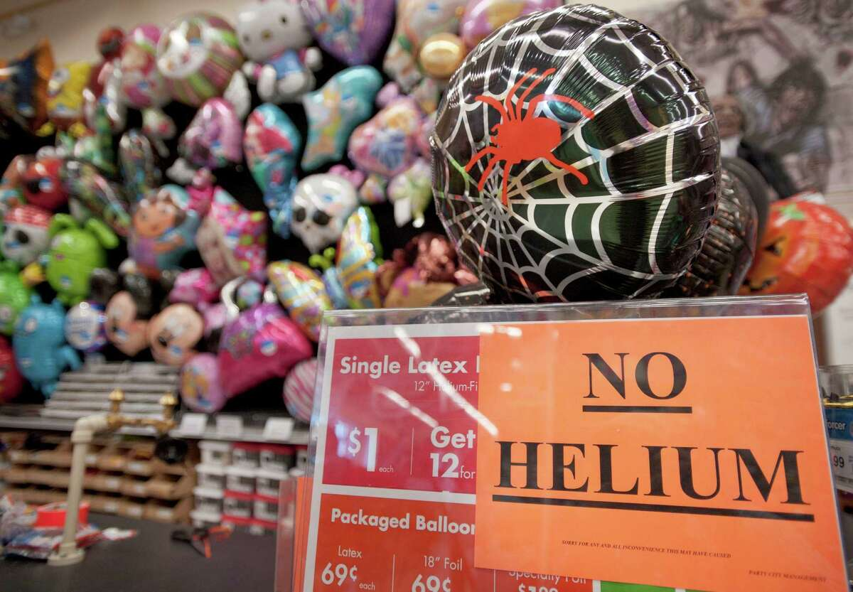A sign informing customers of a helium shortage is posted at a party balloon filling station, Wednesday, Oct. 3, 2012, at a Party City location in San Antonio.