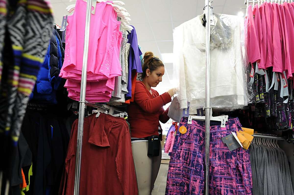 Jazmin Negrete works on a stocking a rack of young womens clothing at the new CityTarget store, which is set to open on the 14th, at the renovated Metreon in San Francisco, Calif., Tuesday October 2nd, 2012.