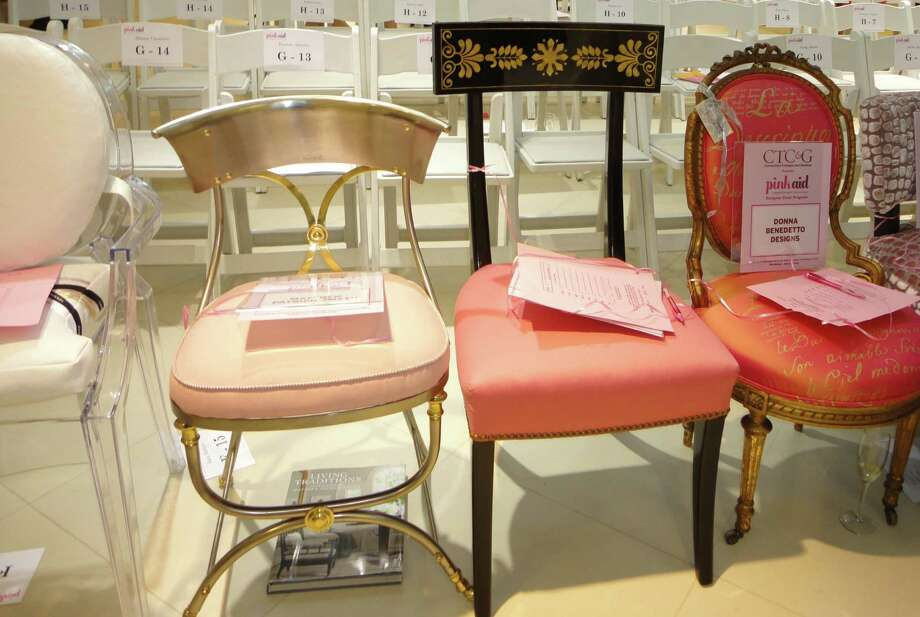 Thirty-two one-of-a-kind pink chairs were auctioned Thursday for the 2nd annual Pink Aid cancer charity event at Mitchells of Westport. Photo: Meg Barone / Westport News freelance
