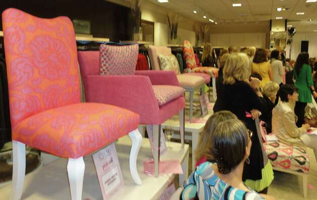 The Pink Aid event Thursday at Mitchells of Westport included a fashion show featuring breast cancer survivors as the models and the auction of 32 pink chairs created especially for the cancer charity event. Photo: Meg Barone / Westport News freelance