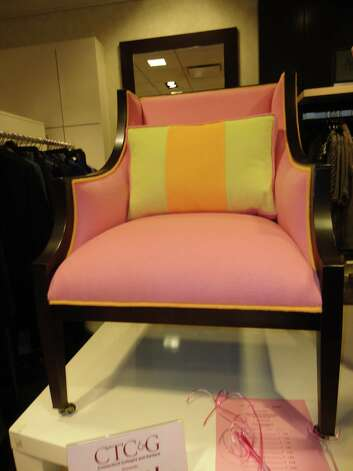 Pink chair by Lillian August at Thursday's Pink Aid fundraiser at Mitchells of Westport. Photo: Meg Barone / Westport News freelance