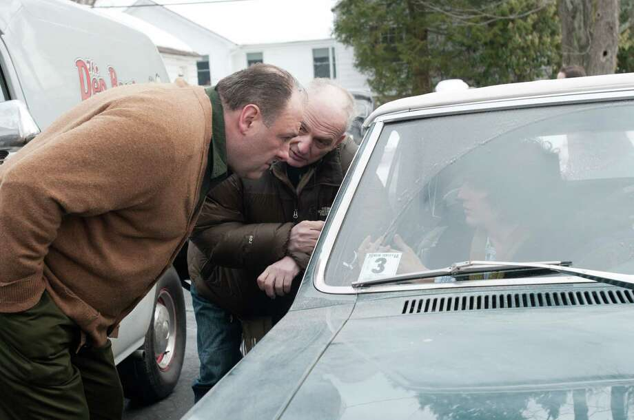 """This film image released by Paramount Vantage shows James Gandolfini, left, with writer-director David Chase during the filming of """"Not Fade Away."""" The film is Chase's first movie and his long-awaited follow-up to """"The Sopranos,"""" the venerated HBO drama he created and produced for six seasons. The '60s rock 'n' roll drama is set around a suburban teenager in New Jersey whose garage band aspires to be the next Rolling Stones, an ambition at odds with his traditional Italian father, played by James Gandolfini. Photo: Paramount Vantage, Barry Wetcher"""