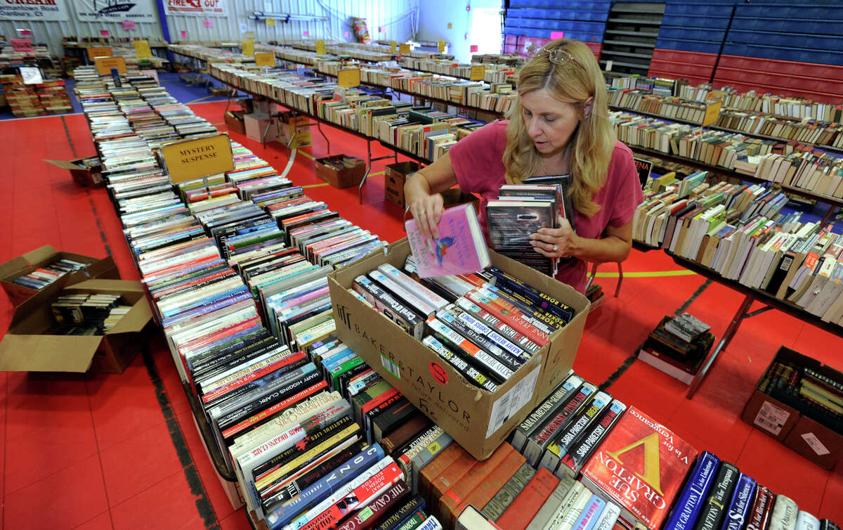 Audrey Price, of Danbury, makes final preparations Friday for the Friends of the Danbury Library Book Sale. The book sale, being held at the Police Activities League Building at 35 Hayestown Road, will run Saturday through Monday.