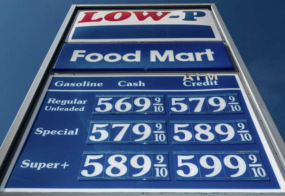 Our gas is just a wee bit cheaper than California's.  By the way, we wonder what Low-P stands for.  Clearly not low prices. Photo: Damian Dovarganes, Associated Press / AP