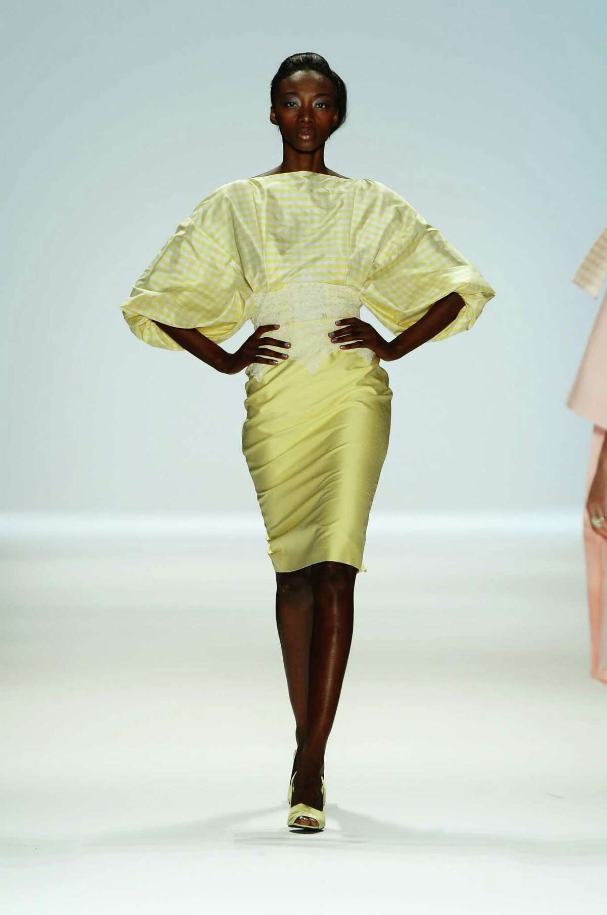 A models walks the runway in a Zang Toi design during New York Fashion Week.