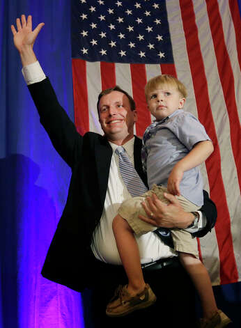 Democrat U.S. Rep. Chris Murphy waves to supporters as he holds his son, Owen, 4, during the celebration of his primary victory in New Haven, Conn. Tuesday, Aug. 14, 2012 for the open U.S. Senate seat being vacated by retiring U.S. Sen. Joe Lieberman. (AP Photo/Elise Amendola) Photo: Contributed Photo/ Elise Amendol, Contributed Photo / The News-Times Contributed