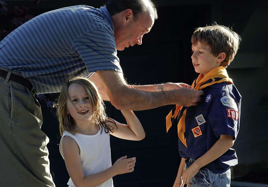 John Palmer of San Francisco, shown adjusting the uniform of son Miles, 7, and with daughter Linda, 5. Photo: Michael Macor, The Chronicle