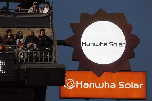 The new automated Hanwha Solar sign hangs above left field at AT&T Park. Photo: Carlos Avila Gonzalez, The Chronicle