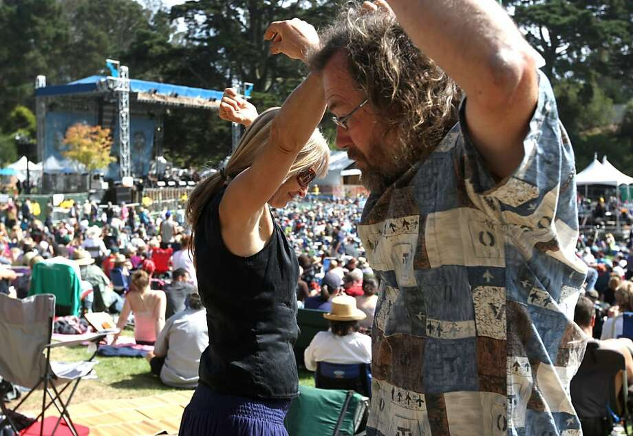 "Elaine Stanton, left and Roland Badertscher dance to the sounds of Chuck Mead & His Grassy Knoll Boys during the first day of Hardly Strictly Bluegrass in Golden Gate Park. ""Friday is my favorite day because it's the least amount of people and the most obscure bands,"" Elaine said. Photo: Luanne Dietz, The Chronicle"
