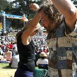 "Elaine Stanton, left and Roland Badertscher dance to the sounds of Chuck Mead & His Grassy Knoll Boys during the first day of Hardly Strictly Bluegrass in Golden Gate Park. ""Friday is my favorite day because it's the least amount of people and the most obscure bands,"" Elaine said."