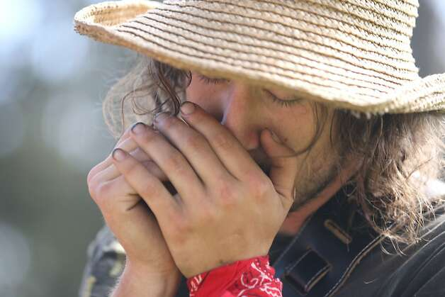 Jake Dore plays the Harmonica with his traveling band Itty Bitty String Band, outside the Porch Stage before festivities get under way at the first day of Hardly Strictly Bluegrass in Golden Gate Park on October 5, 2012. Photo: Luanne Dietz, The Chronicle