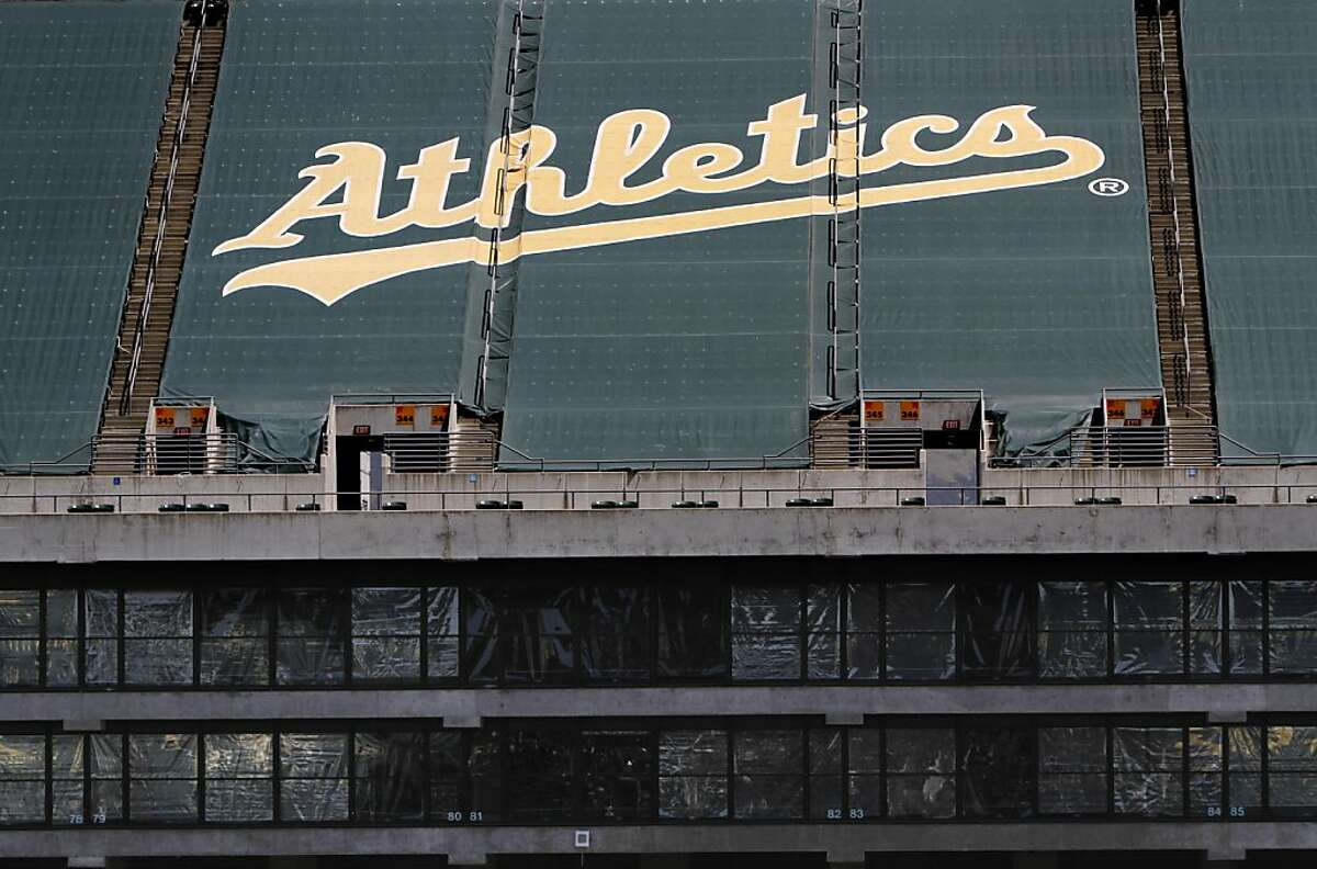 The majority of the upper bowl at the O.Co Coliseum is closed to fans, and the seats are covered with green tarps painted with the team name. The luxury boxes shown are not being used during the Oakland A's game against the Blue Jays in Oakland, Calif., Wednesday, May 9, 2012.