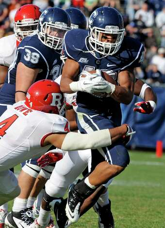 Rutgers' David Rowe, left, attempts to tackle Connecticut's Lyle McCombs during the first half of an NCAA college football game in East Hartford, Conn., on Saturday, Nov. 26, 2011. (AP Photo/Fred Beckham) Photo: Fred Beckham, Associated Press / Associated Press